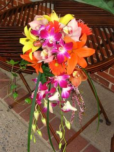 This is a little more colorful but it feels like it could be overpowering.  Play with the flowers! Beach Wedding Bouquets