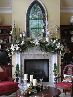 35 Beautiful Christmas Mantels - Christmas Decorating - stained glass window-like piece hanging above the mantel Christmas Fireplace, Christmas Mantels, Winter Christmas, All Things Christmas, Christmas Home, Christmas Garlands, Christmas Villages, Green Christmas, Beautiful Christmas