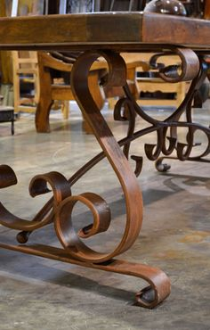 The Mesa Espanola Mesquite Table is made with a thick, solid mesquite wood tabletop. Classically paired with a scrolled, hand forged, wrought iron base.