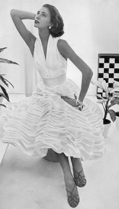 Suzy Parker, photo by John Rawlings, Vogue, January 1, 1952
