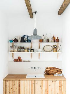 pine wood kitchenette in minimalist studio. / sfgirlbybay