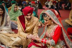 Sikh bride and groom exchanging rings. https://www.maharaniweddings.com/gallery/photo/140730