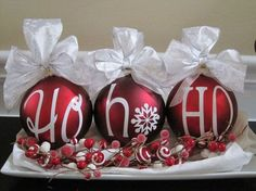 Red Ornament Christmas Table Centerpiece With Silver Bows.