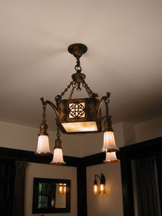 "Wonderful Craftsman fixture with Stuben shades. Shades on wall sconces are "" Iridile"" from McBeth-Evans"