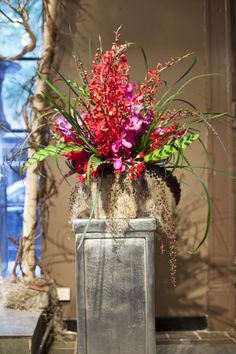 I like the idea of tall crates with spanish moss and items on top for height and interest