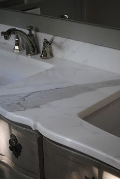 thinking about putting marble in my bathroom and replacing the granite on the kitchen island with marble. i like it.