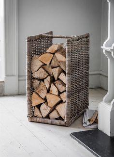 Garden Trading Bembridge log holder in Kubu rattan. Vertical rattan log store for storing firewood by Garden Trading. Firewood Rack Plans, Outdoor Firewood Rack, Firewood Storage, Storage Baskets, Storage Ideas, Storage Solutions, Firewood Basket, Firewood Holder, Pouf Design