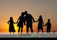 family beach photo idea.  Silhouette of family at sunset.