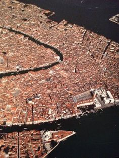 Venice // From the book: Earth from Above. I love this pic, and have spent many hours wandering from St. Marks Plaza (forground, right) thru the maze that Venice is, working my way to the Rialto bridge (center)