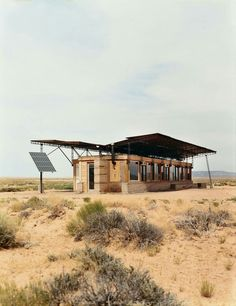 Entirely off the grid, the tiny house is powered by four photovoltaic panels that supply electricity to lights, small appliances, and more. On the Colorado Plateau. Click through for slide show. / The Green Life Le Ranch, Rammed Earth Homes, Desert Homes, Energy Efficient Homes, Construction, Prefab, Solar Panels, Pv Panels, My House