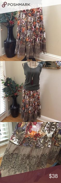 "💝Peter Nygard stunning embroidered detail maxi! 💝Peter Nygard stunning unique embroidered detail maxi skirt. This is an awesome skirt with olive embroidered details running down the length of the skirt. Also the trim on the bottom with a layer of mesh. Rust lavender blush orange cream and olive make this an instant hit anywhere you go. Have received numerous compliments on this skirt. Fully lined. Preloved in excellent condition. Waist lying flat is 13.5"". Zippered side with hook/eye…"