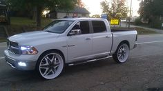 Custom Dodge Ram with rims  | and here is a ram with 5 spoke 30 rims