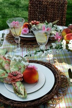 Floating flowers in the lemonade & the peach on the plate.
