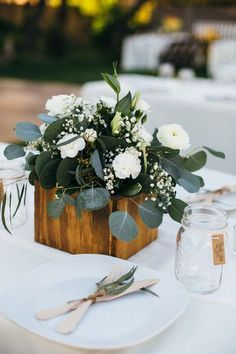 Elegant + simple wedding centerpiece idea - wooden boxes with ranunculuses, silver dollar eucalyptus and baby's breath {Suzy Goodrick Photography}