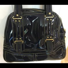 """Maxx Dark Blue Ink Handbag Really pretty and different Maxx handbag.  Dark blue ink patent leather-like handbag with gold stitching and gold hardware.  Compliments abound when you carry this bag.  Dimensions:  Width - 10.5"""", Height - 8.5"""", Strap drop - 6"""".  Inside it has zipper pockets on each side and two pockets that could fit lipsticks/sunglasses.  Cool black and white zebra print liner. Maxx New York Bags"""
