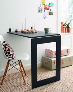 The mirror folds down to a fold-down table. Can You Guess What Secret this DIY Mirror is Hiding? — Home Story DIY on the German website Home Story (here's the translated tutorial).