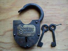 This is so cool -- Sheriff Department Padlock -- This site has tons of antique locks, including Alcatraz Prisoner padlocks.