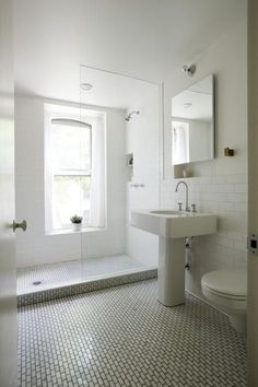Perfect for the guest bathroom. White tile halfway up, all white tile w/ gray grout. Simple industrial materials from Ikea or Home Depot. Wood accents & lots of light.