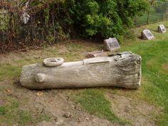 Gravestone shapped like a fallen trunk Saint Mary's Cemetery Marion, Ohio