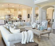 There is just something we love about this fresh, yet warm and inviting living room. Maybe it's the abundance of pillows! We cannot get enough!