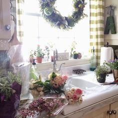 A happy kitchen has plenty of personality! Fresh flowers and charming accents like the moss monogram hanging from a ribbon spell out a cheery space for sure! Sponsored by HomeGoods Happy by Design