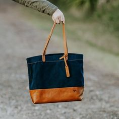 Go from work to the weekend seamlessly thanks to the Madison Waxed Canvas Tote. Made with waxed canvas and top-grain leather, it's a durable carryall bag. Waxed Canvas Bag, Canvas Purse, Canvas Leather, Canvas Tote Bags, Diy Leather Tote, Leather Purses, Leather Craft, Tan Leather, Denim Tote Bags