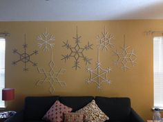 Popsicle stick snowflakes plus spray paint. Perfect for the party! I made up more designs than what I found elsewhere on Pinterest.