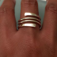 One piece wrap ring. Ring can be adjustable to wear for different fingers. Sterling silver. Beautiful ring wrap around your finger. It looks like you just stack your rings. The bands are made of 1.63mm thick. Flattened in both side. Can stretch or squeeze the ring for you to fit with