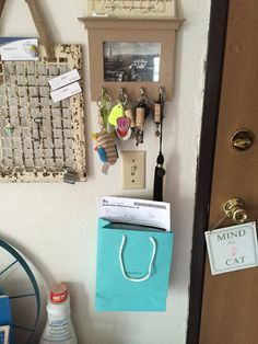 Nailed a Tiffany bag to wall to catch mail that needs to be seen to