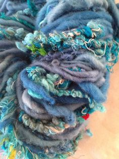 CHUNKY funky art yarn in sunny blues. Contains local fibers from small family farms and fair trade sari silk thrums. Eco-fiber. :)