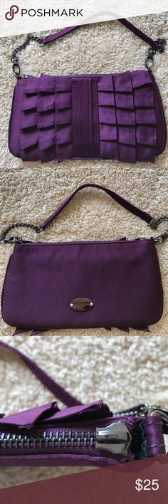 """REDUCED! Nine West small handbag Nine West handbag. Measures 10"""" x 5"""". Chain detail on handle. Dark purple silky material. Toggle is missing on zipper --see picture. Still fully functional. Nine West Bags Mini Bags"""