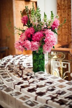 Place cards and favors together: box goodies and label each with the guest's name and table number