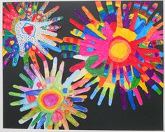 Each child traced their hand, coloured it in, and then the hand was cut out and placed in the artwork by parent helpers. 5-6yr olds.