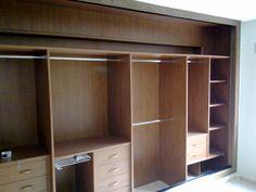 Revestimiento interior de armario, forrando viga y pilar interiores, creando distribución interior acorde a las necesidades del cliente.