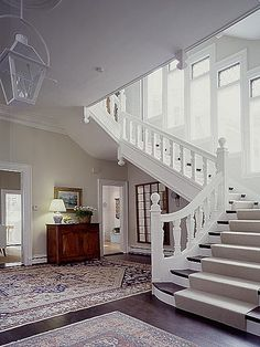 The windows going up the staircase are to die for!  I'd kill for all that natural light!