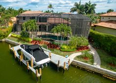 Park Shore Naples Florida Home for Sale. This waterfront home on Venetian Bay features a new boat dock and lift, infinity-edge pool, media room, 4+den/6 bath/5 car garage. Click the photo for more listing details! Offered at $3,998,000.