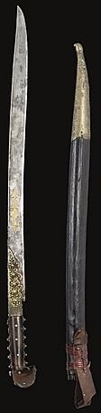 Ottoman yatagan / yataghan, 19th c, straight steel blade with gilt inscription within star and cartouches to one side and tugra and longer inscription to other with date 1237AH/1821AD, raised floral bosses to forte and to horn hilt, the leather scabbard with gold stitching, brass end, the date 1237AH/1821AD embossed in leather - 27 1/2in (69.7cm).
