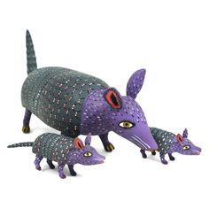 Sergio Santos is a well known carving artist from the remote village of Tejalpa, La Union in Oaxaca. The great charm of the figures of this region is their primitive and rustic features.This is Sergio's classic armadillo with babies.