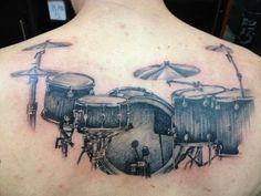 a guy tattoo of drum set.