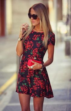 I love this black dress with the red roses and a red clutch to match.