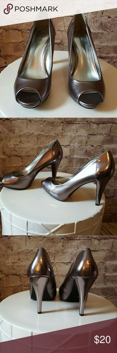 "NWOT Style & Co heels Beautiful shiny silver heels. Brand new. Heels measures 4"" Style & Co Shoes Heels"