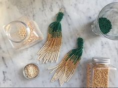 Here is a guide on how to make these supertrendy earrings, using glass beads. Vary the colors however you like. Such a cool DIY! #seaglassearringsideas