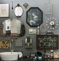 vintage mirrors and quirky objects on a bathroom wall