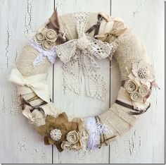 My, oh my!  It does not get much cuter than this cream, shabby chic, wreath.  Really, you could adjust the style just a bit for winter, spring, summer, OR fall! vintage wreath. cream wreath.  DIY wreath.