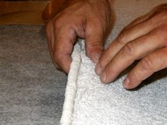 DIY: Bond the edge of a carpet remnant to turn into an area rug. Super easy!