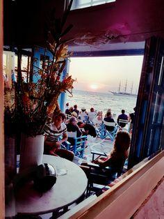 On the Seafront of Little Venice with a Stunning View of the Aegean Sunset #caprice #capricebarmykonos #capriceofmykonos #traveldestinations #bestdestinations #travelbucketlist #travelgreece #visitmykonos #sunsetgreece #sunsetaesthetic Amazing Destinations, Travel Destinations, Stunning View, Greece Travel, Mykonos, Windmill, Venice, Landscape Photography, Island