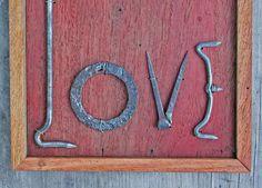 Found Object LOVE sign Folk Art Wall hanging primitive blacksmith heart. via Etsy.