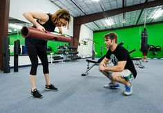 Jeremy Taylor, right, watches Debby Hubley's form as she lifts a length of pipe on Wednesday, Aug. 26, 2015, at Life Changing Fitness in Tyler. Mrs. Hubley said she likes Taylor's approach of teaching why she's doing a specific exercise in addition to how it works so she can do her workouts outside the gym. Andrew D. Brosig/Tyler Morning Telegraph