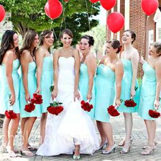 Love the light light teal bridesmaid dress color with the red flowers