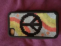 My first attempt at cross stitch iphone cases.